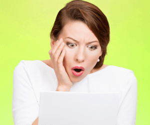 Shocked-woman-reads-billing-statement-that-came-in-the-mail-Shutterstock-800x430